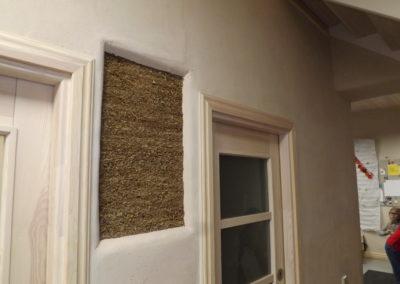 Spaccato interno di una struttura realizzata con pannelli in paglia - Garanzia di qualità e salute